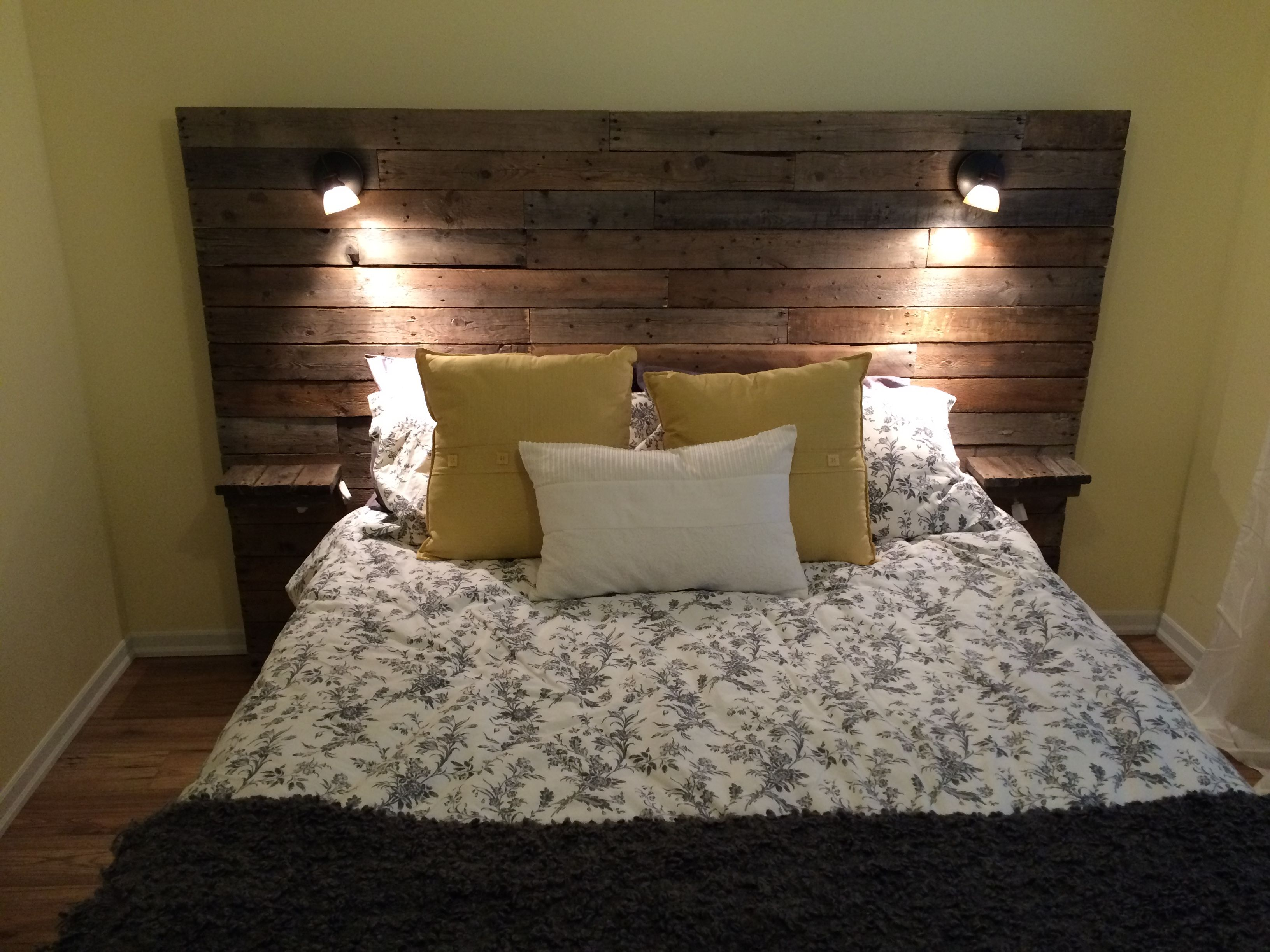 Pallet headboard with shelf lights and plugs for cell phones