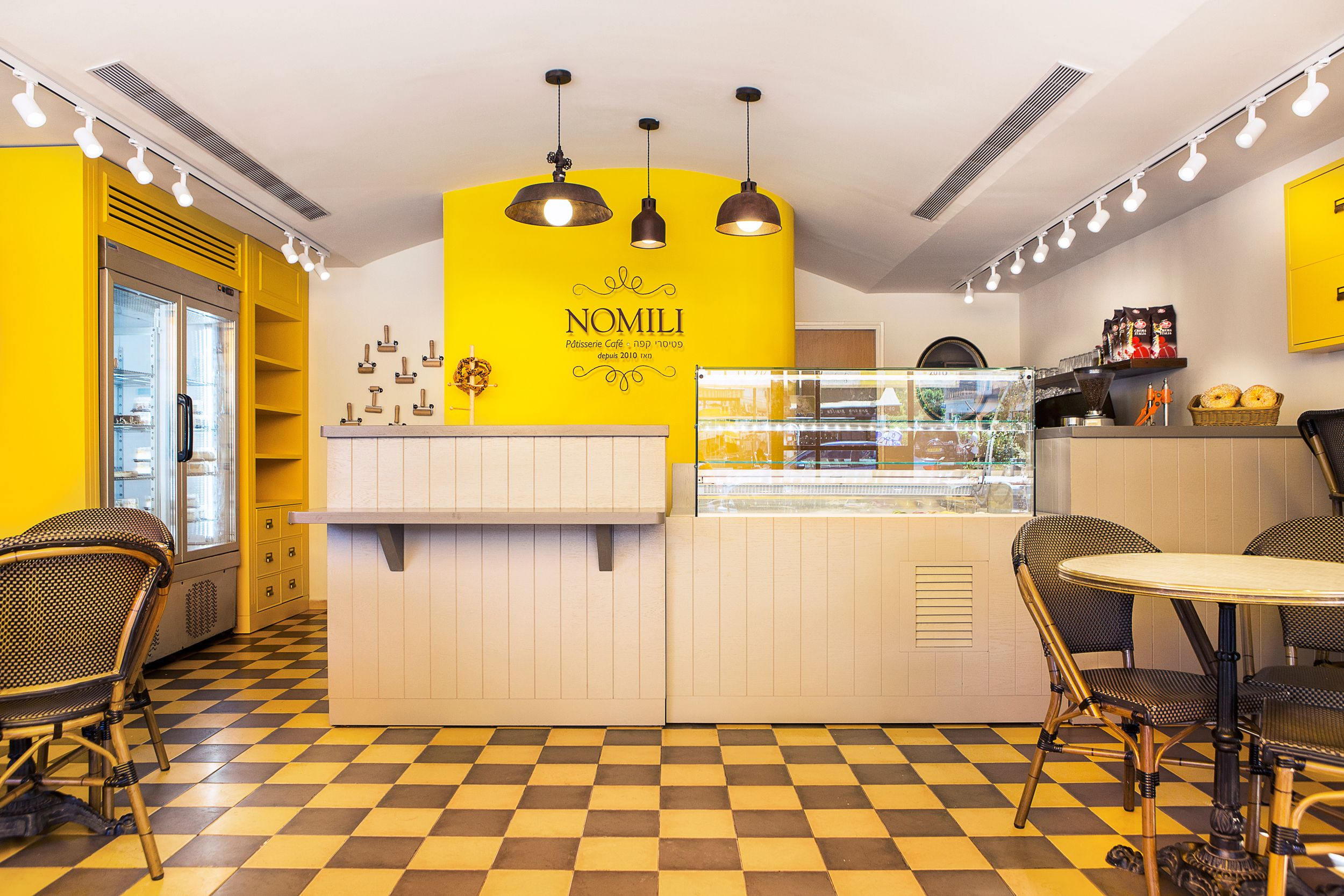 nomili patisserie coffee shop designeddana shaked yellow wall
