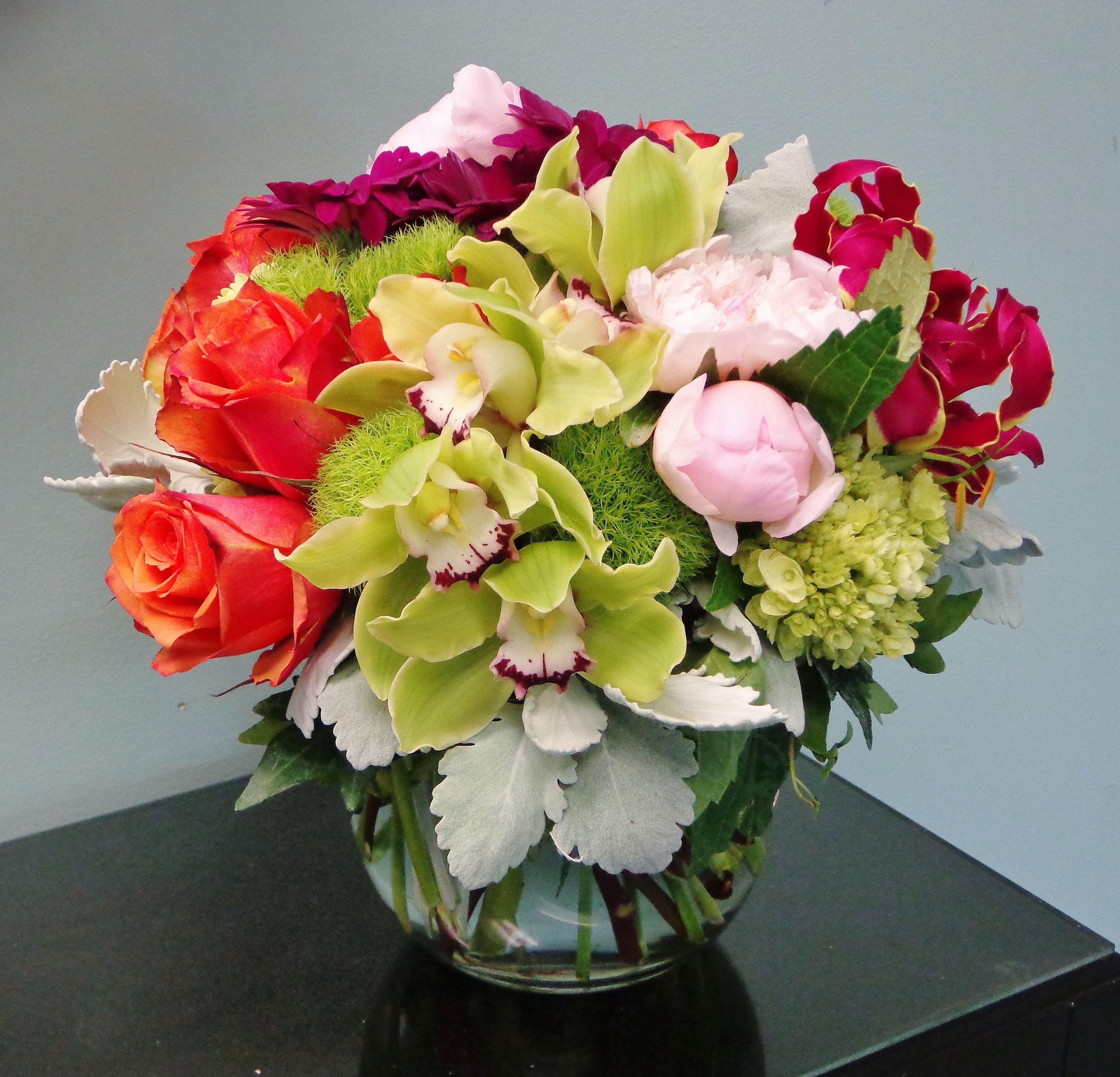 Cymbidium orchids, roses, gloriosa lilies, peonies, gerberas, green trick, viburnun and Lamb's Ear (Dusty Miller)