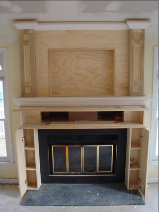 Fireplace cabinetry built-ins: ours will have storage for stacking firewood on both sides with a brick hearth as the base from wall to wall.
