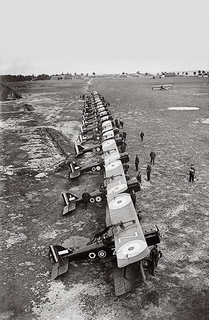 Royal Flying Corps pilots assemble with their S.E.5a Scouts, one of the fastest aircraft of the war.