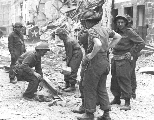 RCE patching a crater in Rue de Bayeux 10 July 1944