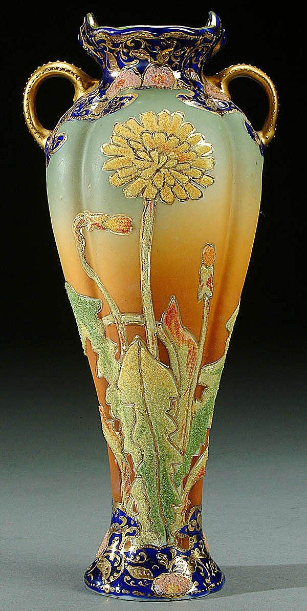 28: A NIPPON CORALENE DECORATED PORCELAIN HANDLED COBLT VASE CIRCA 1909 WITH BEADED GLASS DECORATION OF MUMS ONAM AMBER TO GREEN SATIN GROUND