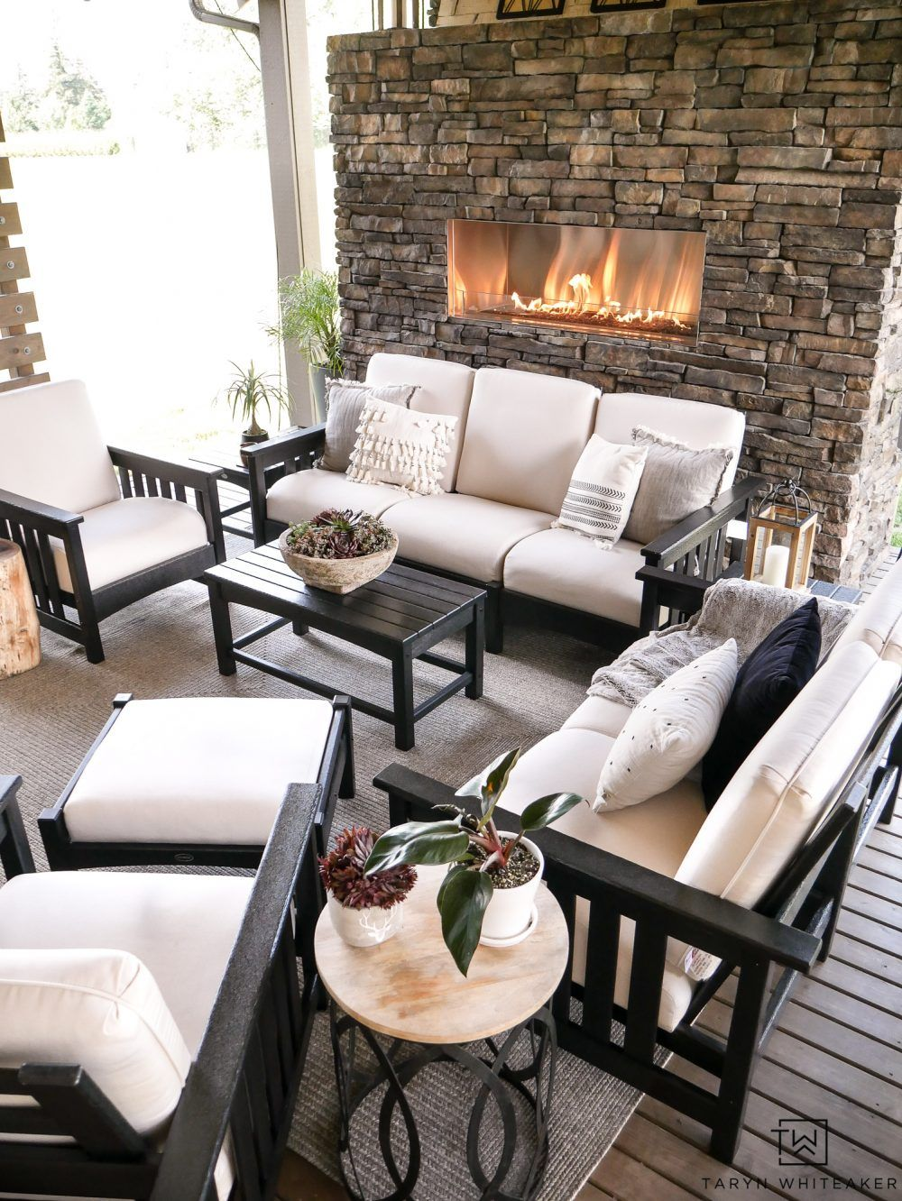 Luxurious Outdoor Living E With Stone Fireplace And Beautiful Black White Patio Furniture Outdoore Outdoorliving Patiodecor