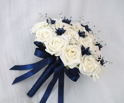 Brides posy bouquet in ivory, navy blue and silver | Feathers, Ivory ...