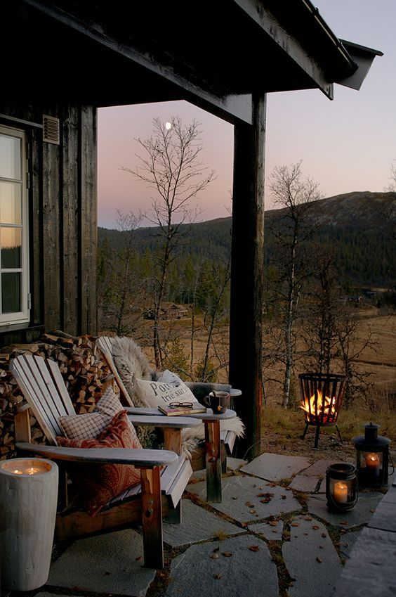 Such a cozy scene with the fire pit and candles lit.Creating An Outdoor Oasis - Five Ways — Hurd & Honey