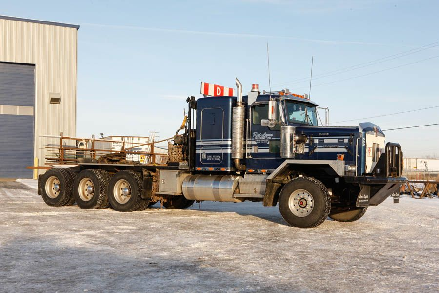 KW tri axle with custom push/pull front bumper. Kenworth