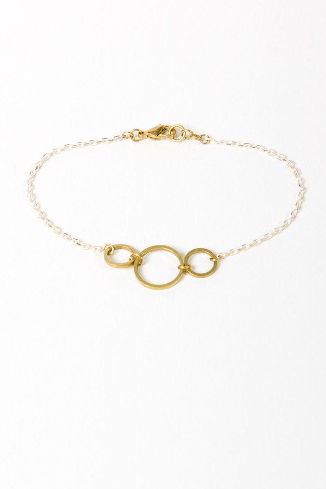 N+n three ring brass bracelet
