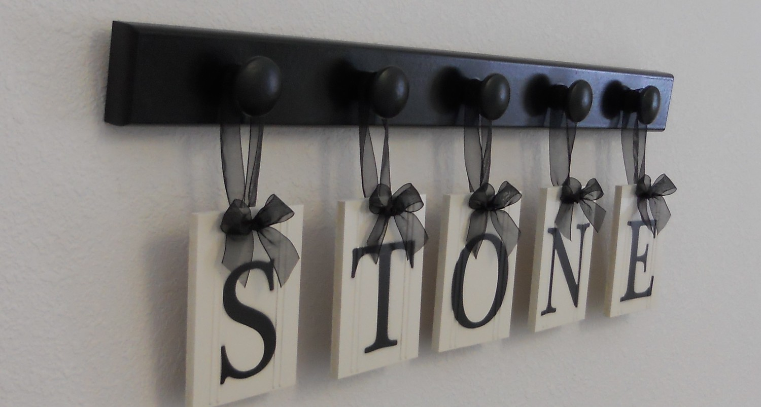 Unique Wedding Gift Idea Family Name Hanging Wood Sign Set Includes Name STONE and 5 Wooden Hooks Black. $25.00, via Etsy.