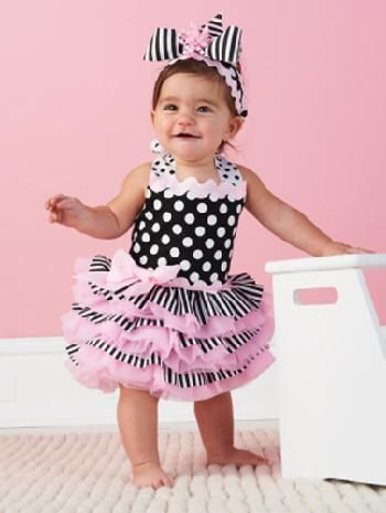 Adorable baby pink nylon pettidress with tons of ruffles and a fabulously full layered skirt. So muc