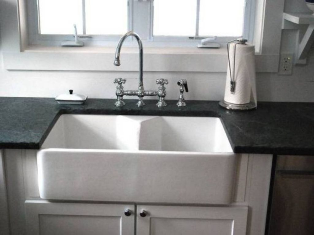 Cast Iron Sink With Double Bowls And Black Countertops Installed ...