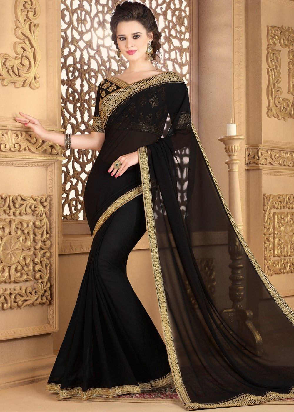 ce1d724cdf Be #party ready in this #black #georgette #saree enhanced by #embroidered  lace border throughout.