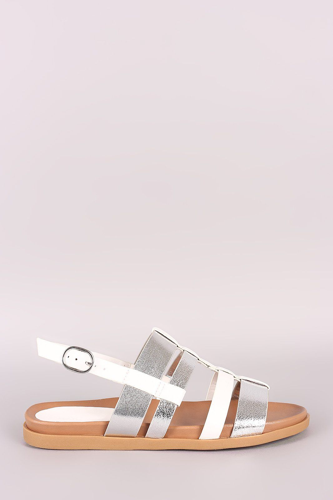 f1a8c83de5e51 This flat sandal features a two tone vegan leather