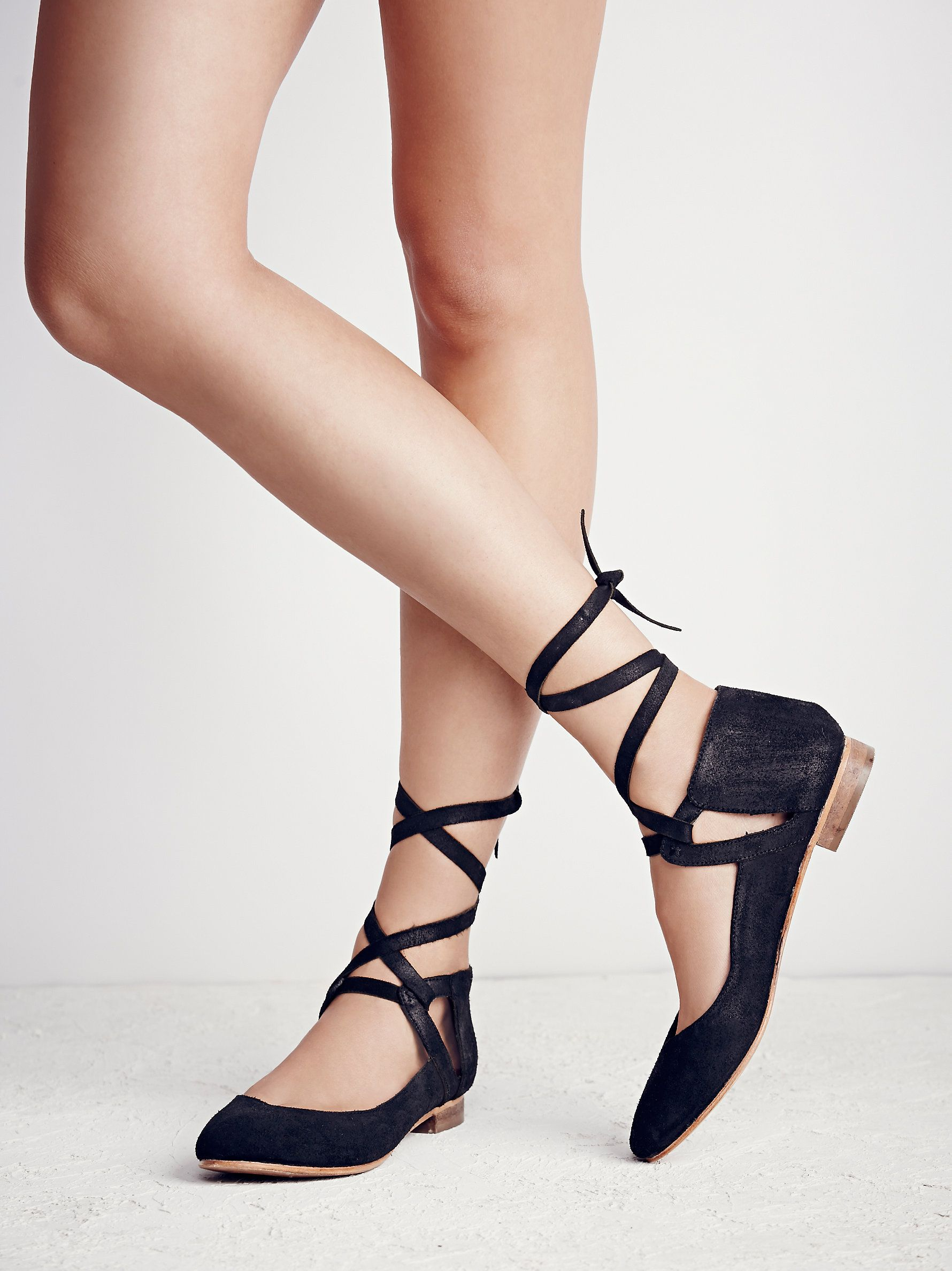 <3 Atlas Flat | Metallic leather or oiled suede ballet flat featuring adjustable ties. Rounded toe and a stacked heel.