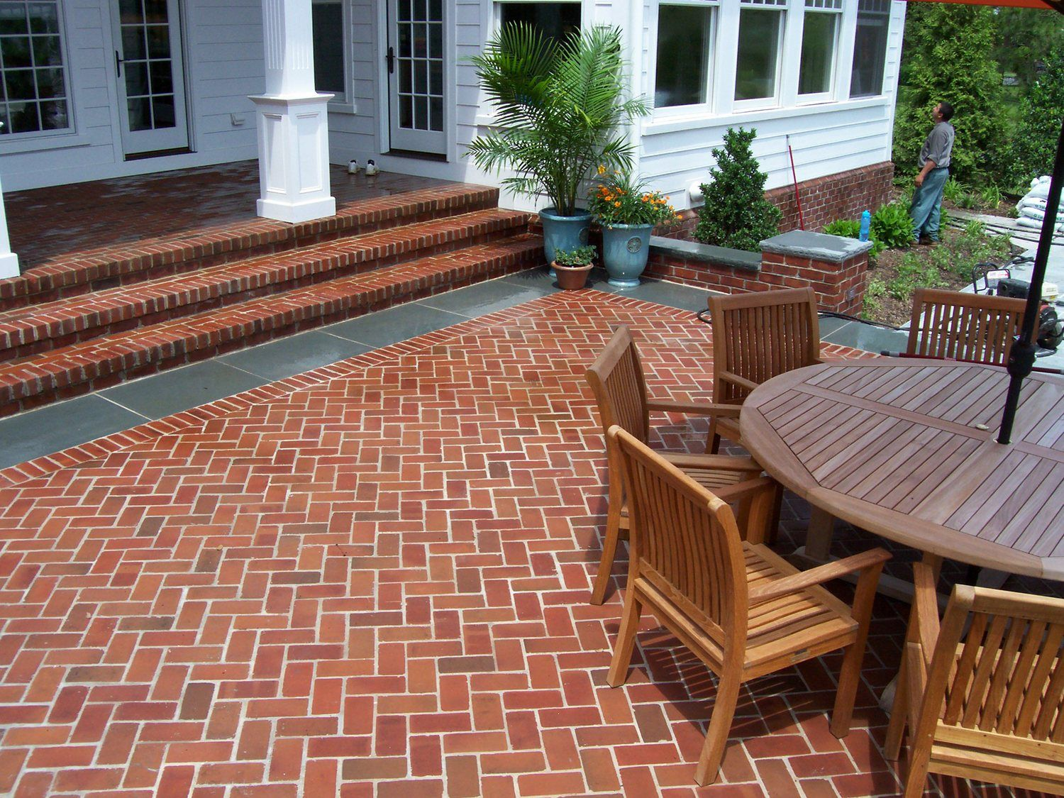 Brick pavers in a herringbone pattern set with a flamed ... on Red Paver Patio Ideas id=11135