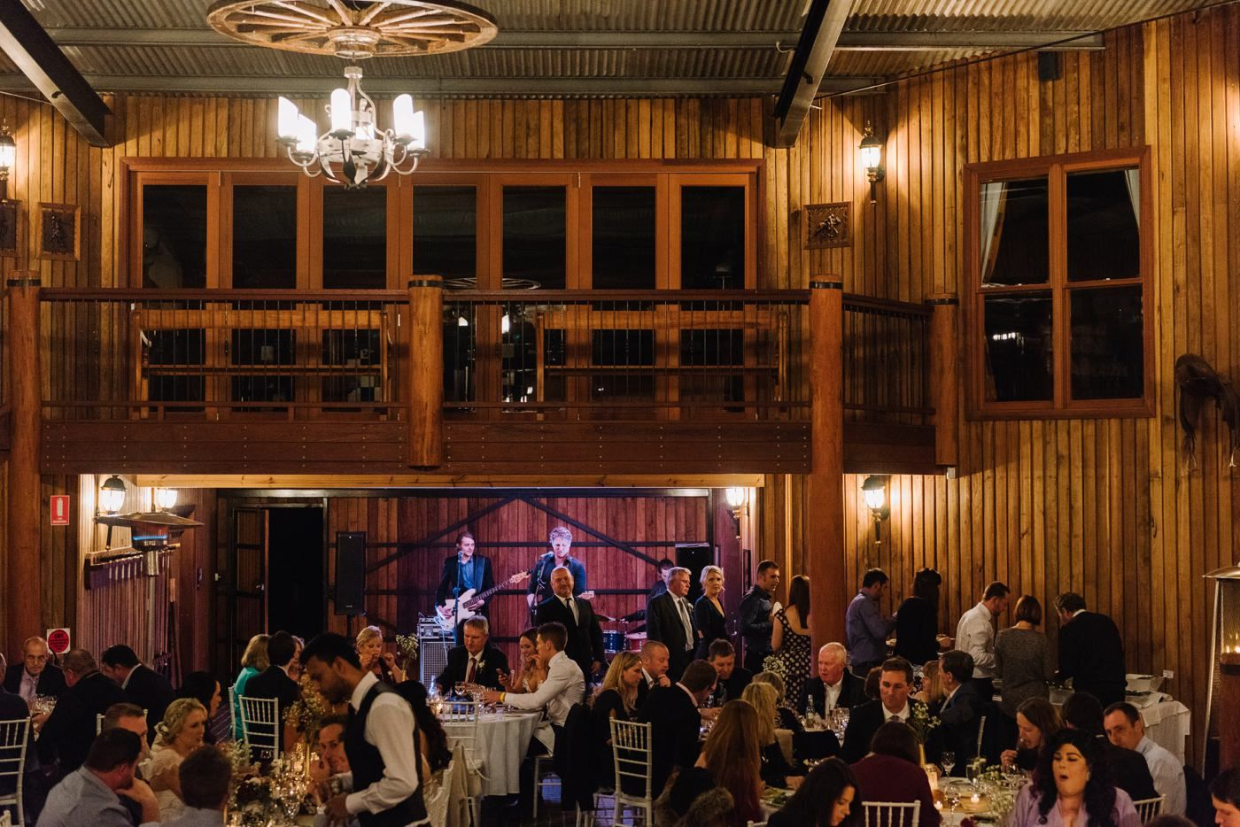 Live music and dancing in the Polo Barn. Sydney Polo Club Winter Wedding. Photography: Sutoritera