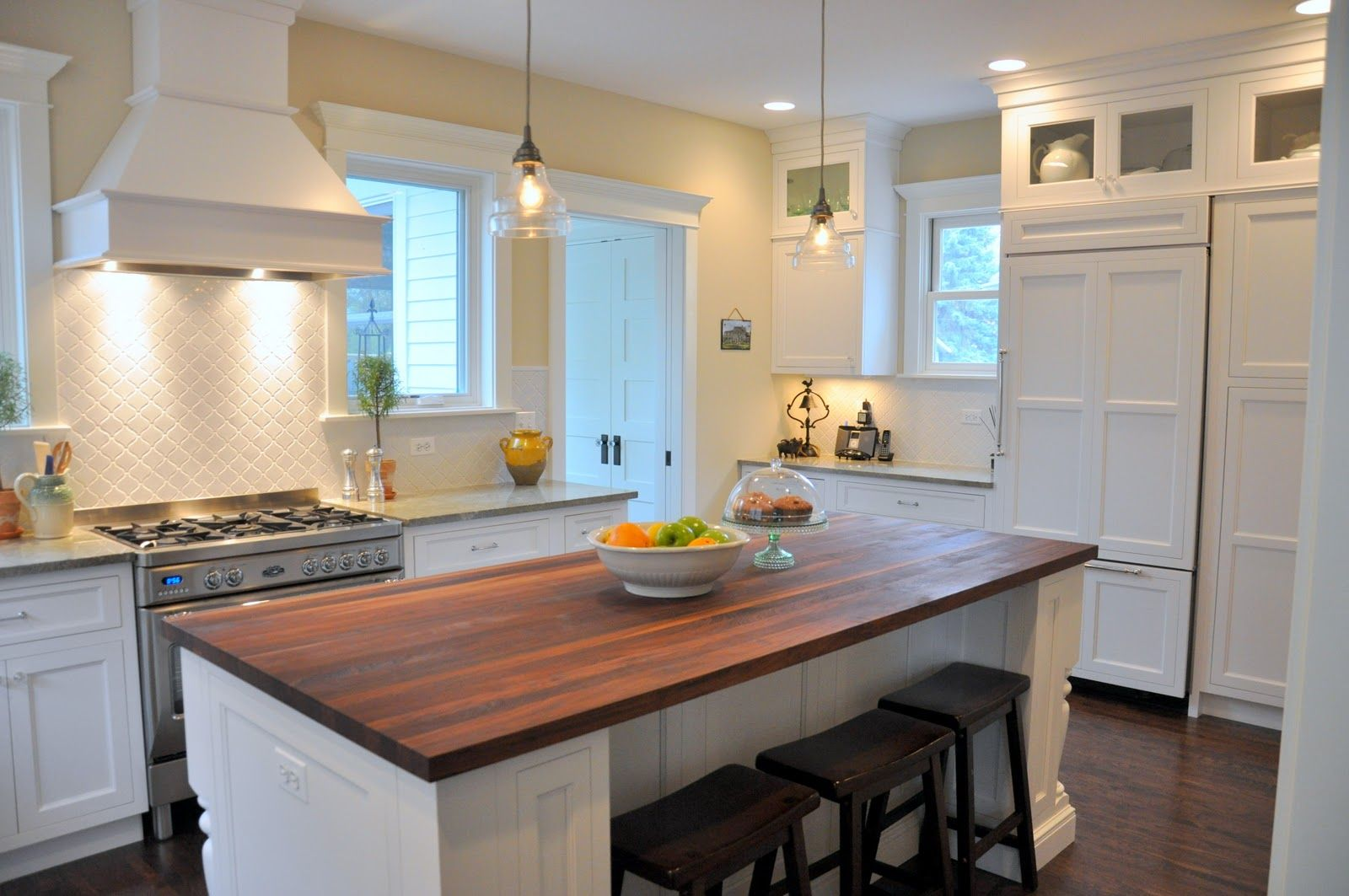 Cozy White And Yellow Kitchen With Pretty Wood Trim, Small Glass Doors,  Tiled Back
