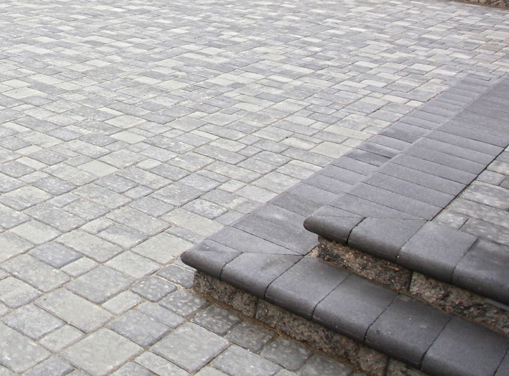 Landscaping Products, Including Many Varieties Of Concrete Pavers, Along  With Wall And Step Units.