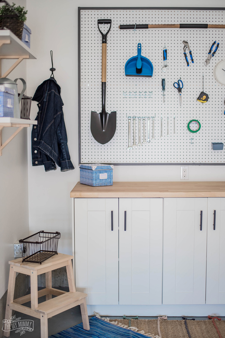 DIY Garage Storage | Build a Work Bench & Framed Pegboard Wall | The DIY Mommy  Instructions to build a framed pegboard wall and work bench from Ikea kitchen cabinets to create cu #Bench #Build #DIY #Framed #Garage #Mommy #Pegboard #Storage #wall #work