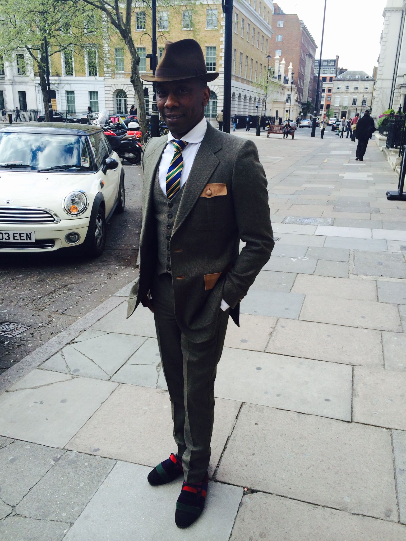 One of the best dressed man on earth.. Watch and learn boys.. Dark green suits with brown pocket details, stripy shoes and socks! Just an other normal Friday in the office!! For more fashion inspiration and style tips check out http://www.stylecoachnyc.com