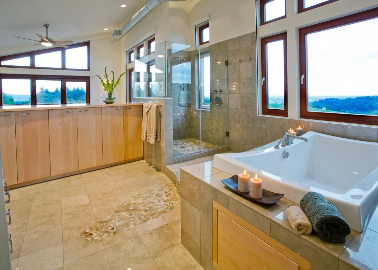 Pebble Tiles · Natural Light Floods This Modern Spa Bathroom Through The  Wood Framed Windows. Neutral,