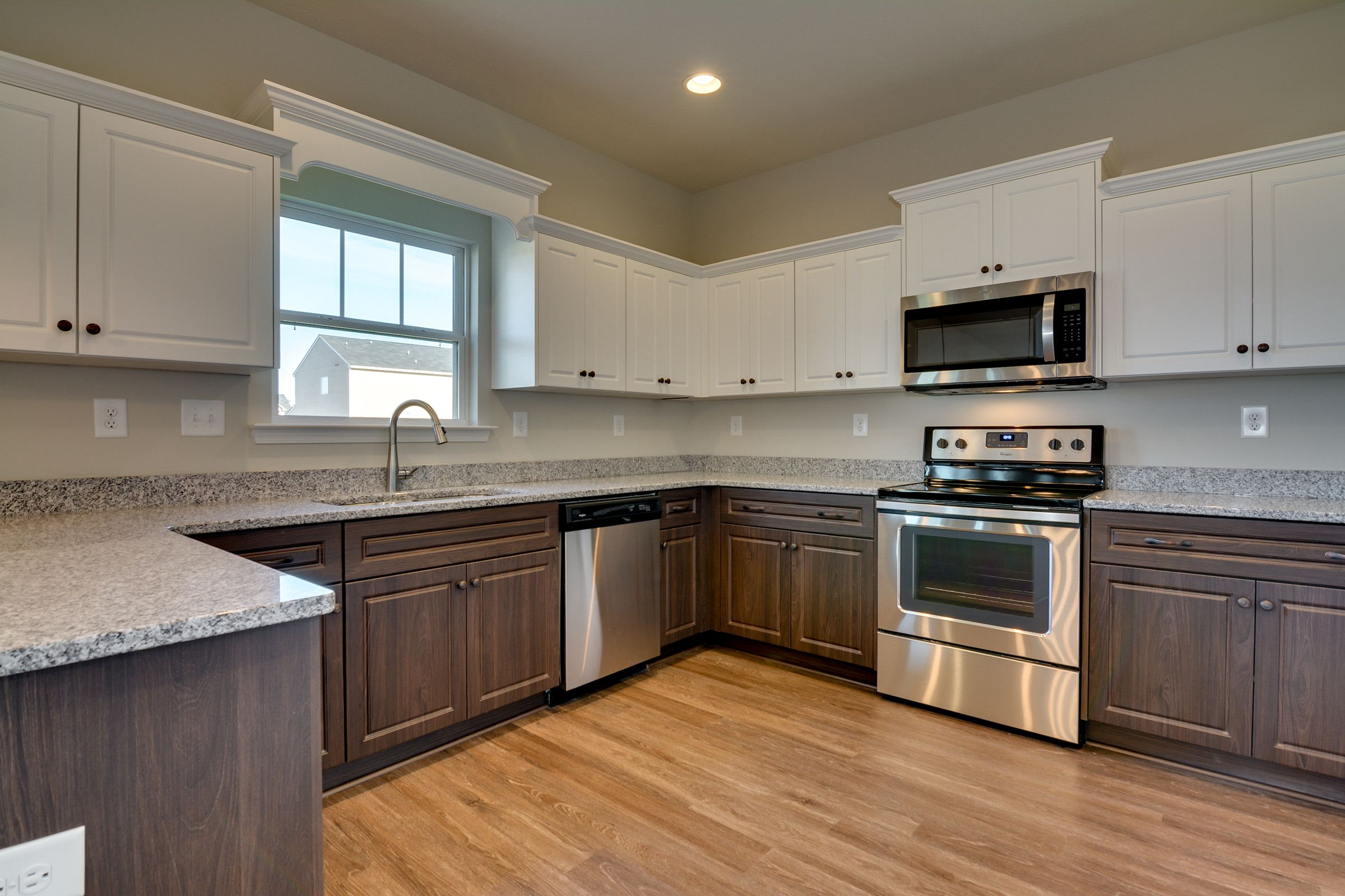 Two Toned Cabinets White Upppers And Wood Grain Vinyl On The Bottom Finding A House Keystone Homes Home