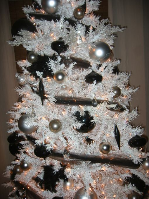 White Christmas Tree With Black, Silver, And Gun Metal Colored Ornaments.