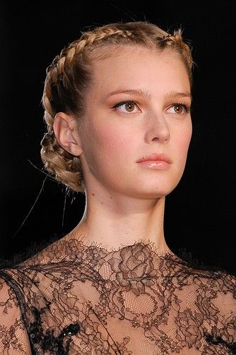 Models looked gorgeous with this braided updo at the Elie Saab show.