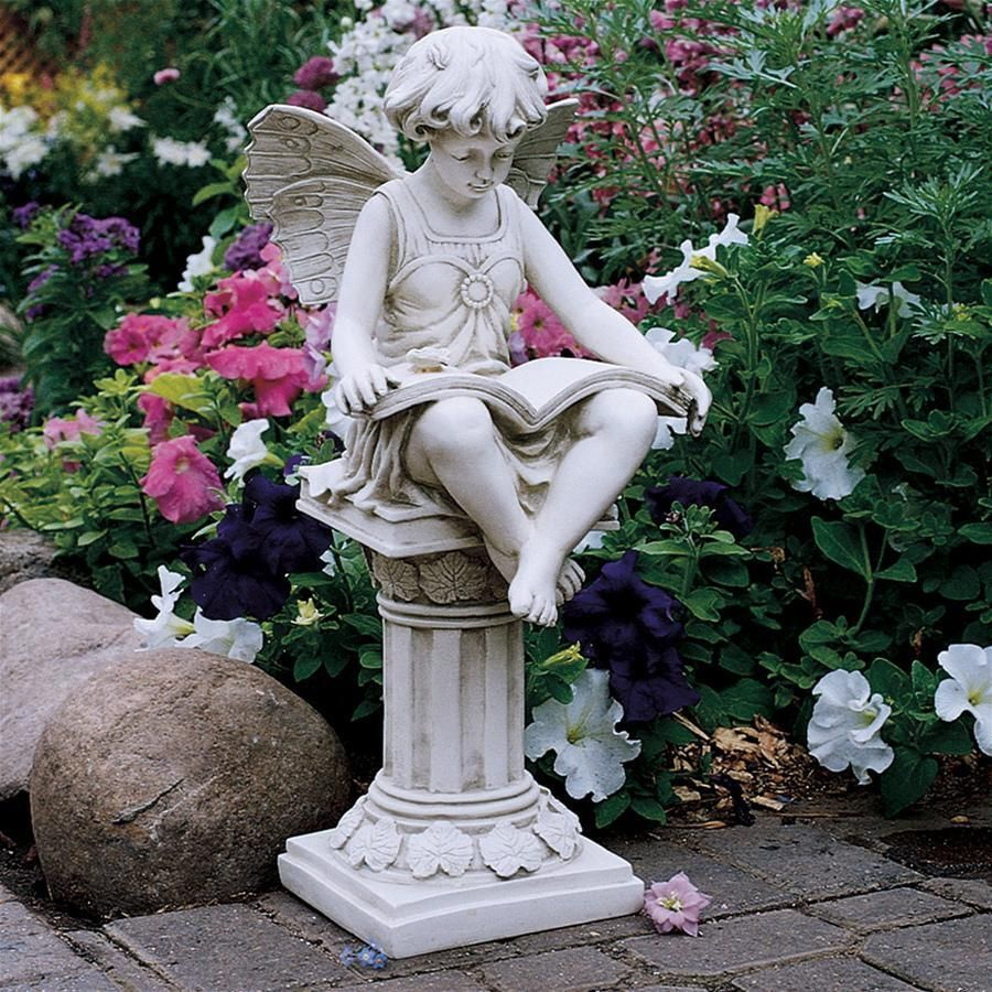 Young Fairy Perched On A Pedestal Reading Her Book. Cute Garden Statue.