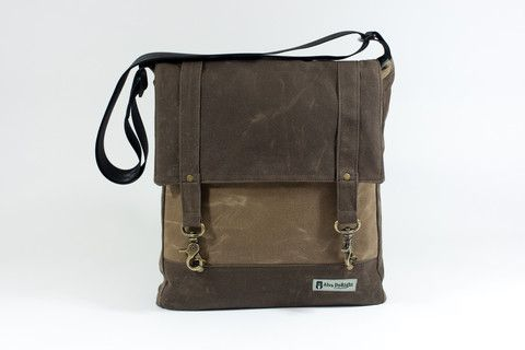 """Rustic Tan/Chocolate Waxed Canvas Features a padded (organic soy batting) interior zip pocket sized to fit all tablets (iPad, Surface...) Two additional pockets on this inside for a total of 3 internal pockets, 2 external pockets. Fits a Macbook Air or Chromebook in main compartment (13""""). Kindle, iPad Mini, and the like fit perfectly in back pocket. Composed of water repellent waxed canvas on the outside + water resistant, recycled nylon on the inside."""