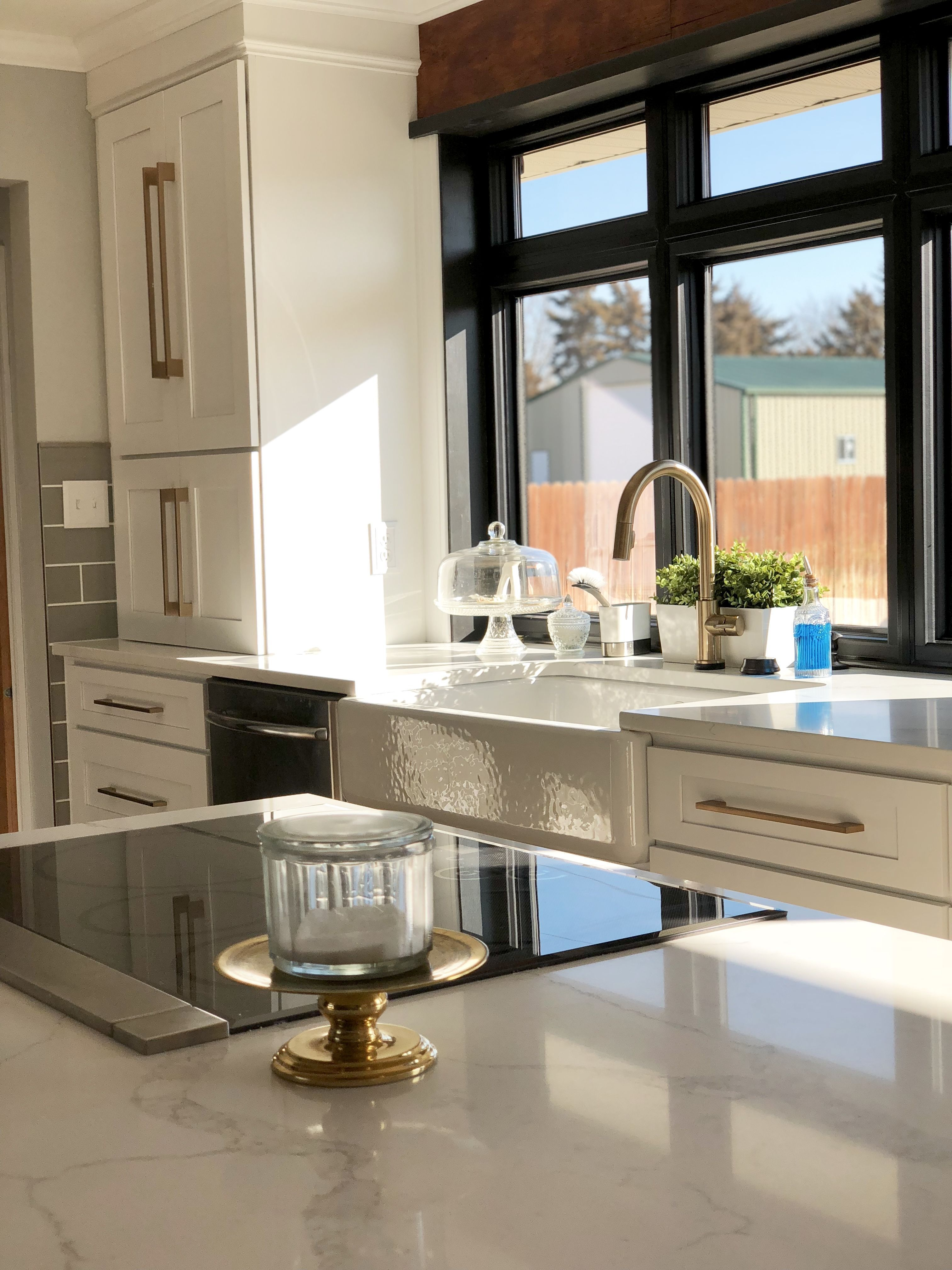 GE Cafe cooktop white cabinets farmhouse sink gold accents GE Cafe cooktop white cabinets farmhouse sink gold accents