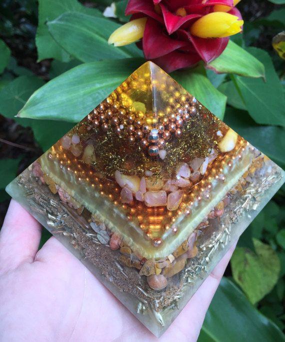 Ao Pyramid of Earth Orgone Generator (large) $98.00 Materials: quartz, quartz crystal, BBs, copper, brass, citrine, jasper, yellow jasper, sand, beach sand, orgone