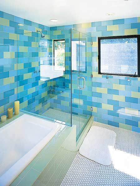 In this south-facing bathroom, oversize tiles in cool blues and ...
