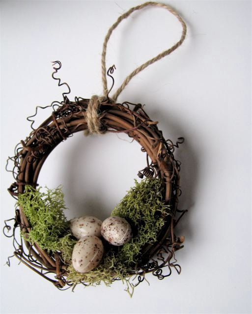Photo of Rustic wreath ornament nest with moss and eggs, garden decor