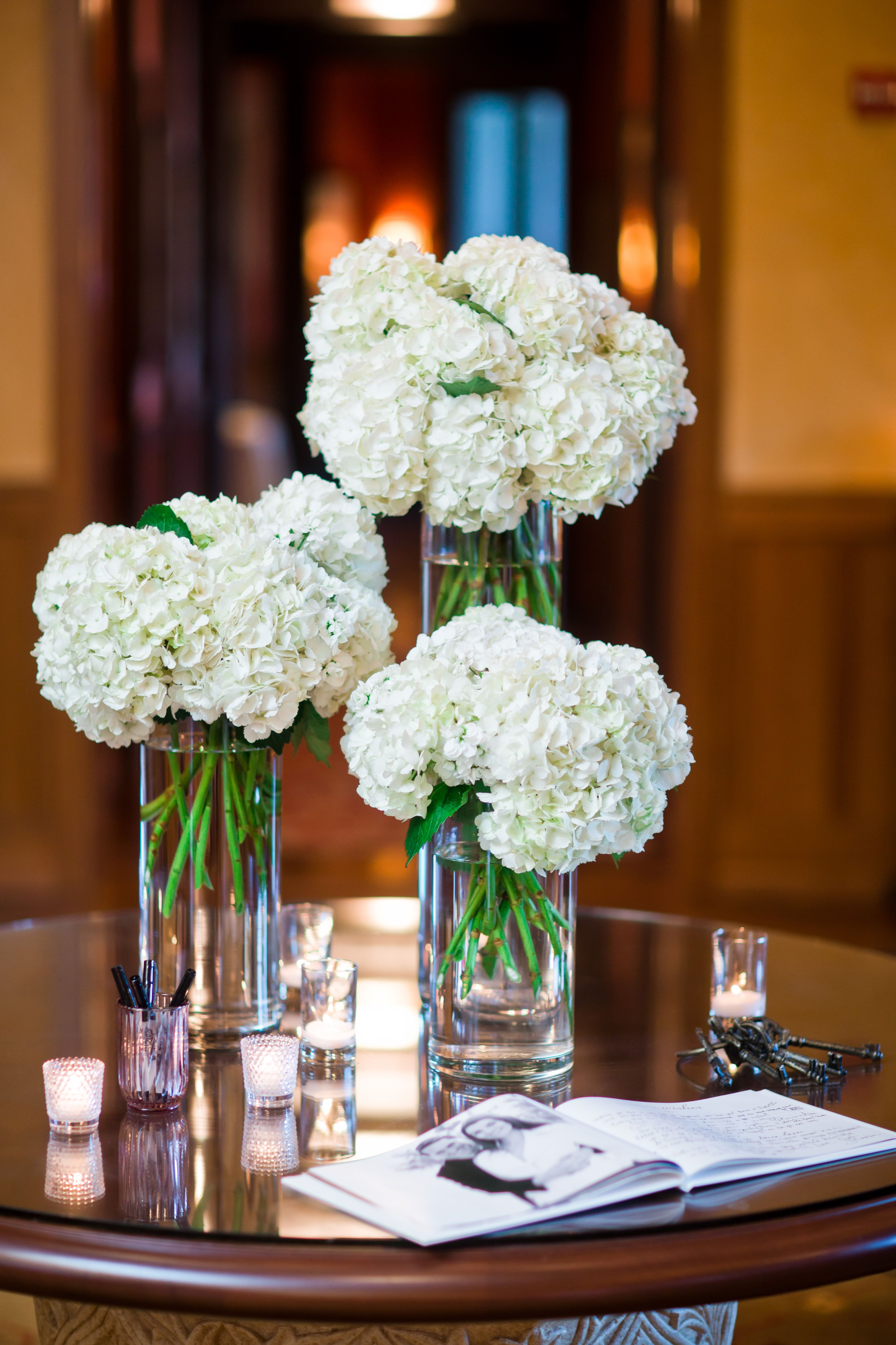 Wedding reception welcome table arrangements white for Where can i buy belaire rose champagne