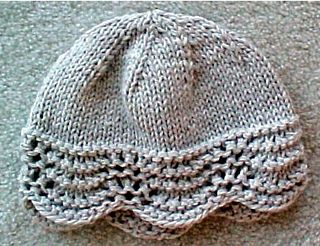 "We get loads of great reviews on this hat pattern! A pretty, lacey, border edge on hat, that is not too difficult to knit. Then on to the top, where it is all stockinette stitch. You finish with a few rounds of decreasing to complete the ""cap"" look for the hat. IT will not take too much time to knit this. This hat fits most people. Uses bulky weight yarns, knitting needles, US #9, in 16 inch circular form. Also a set of # 9 double points for top of hat. You will get rave reviews every time…"