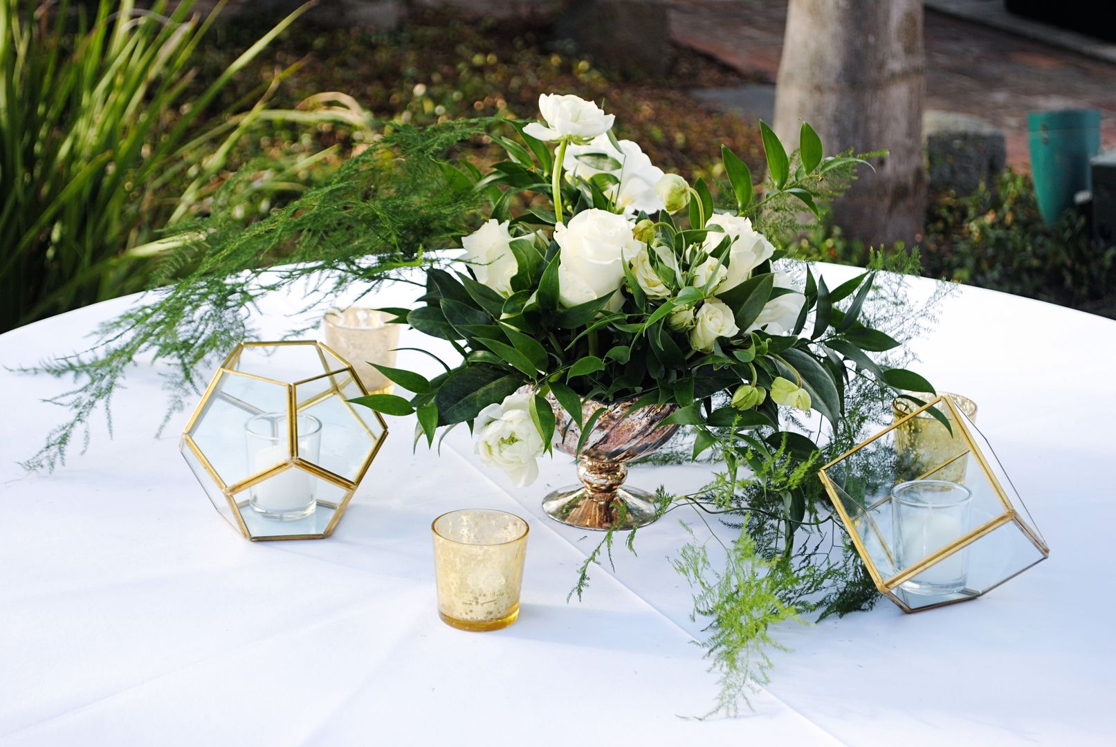neutral florals and geometric candle holders