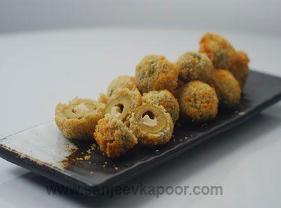 Olive ke pakode recipe stuffed olives dipped in refined flour how to make olive ke pakode recipe by masterchef sanjeev kapoor forumfinder Gallery