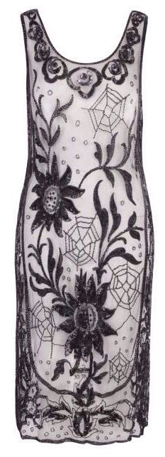 1920s flapper dress decorated in an unusual pattern of spiderwebs and foilage, which are rendered in a mixture of black sequins and beading.