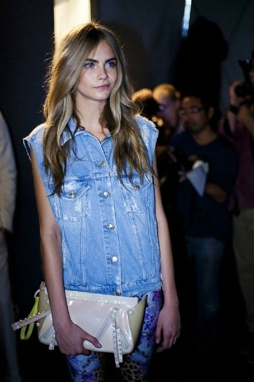 cara delevingne can wear an oversized denim vest and still look good