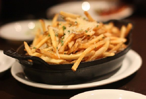 Parmesan and Truffle Oil fries. One of many dishes served in Staub at Fire & Oak Restaurant, New Jersey.
