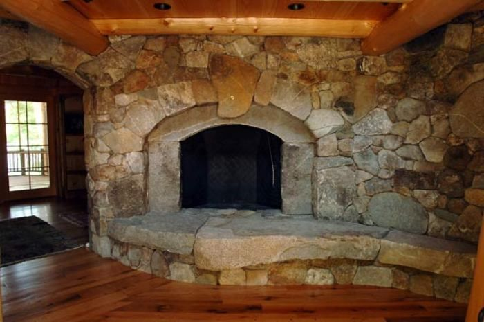 Ancient Stone Fireplace Hearth in Traditional Living Room Design ...
