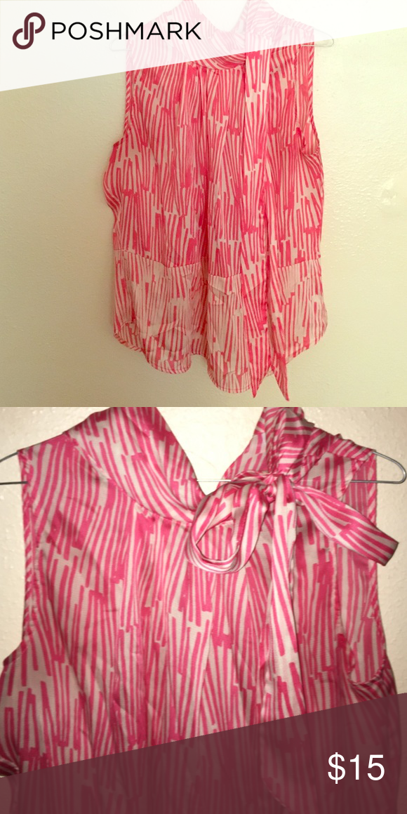 Sleeveless Blouse Pink and white sleeveless tie neck blouse. Great condition. Lightweight sheer material. New York & Company Tops Blouses