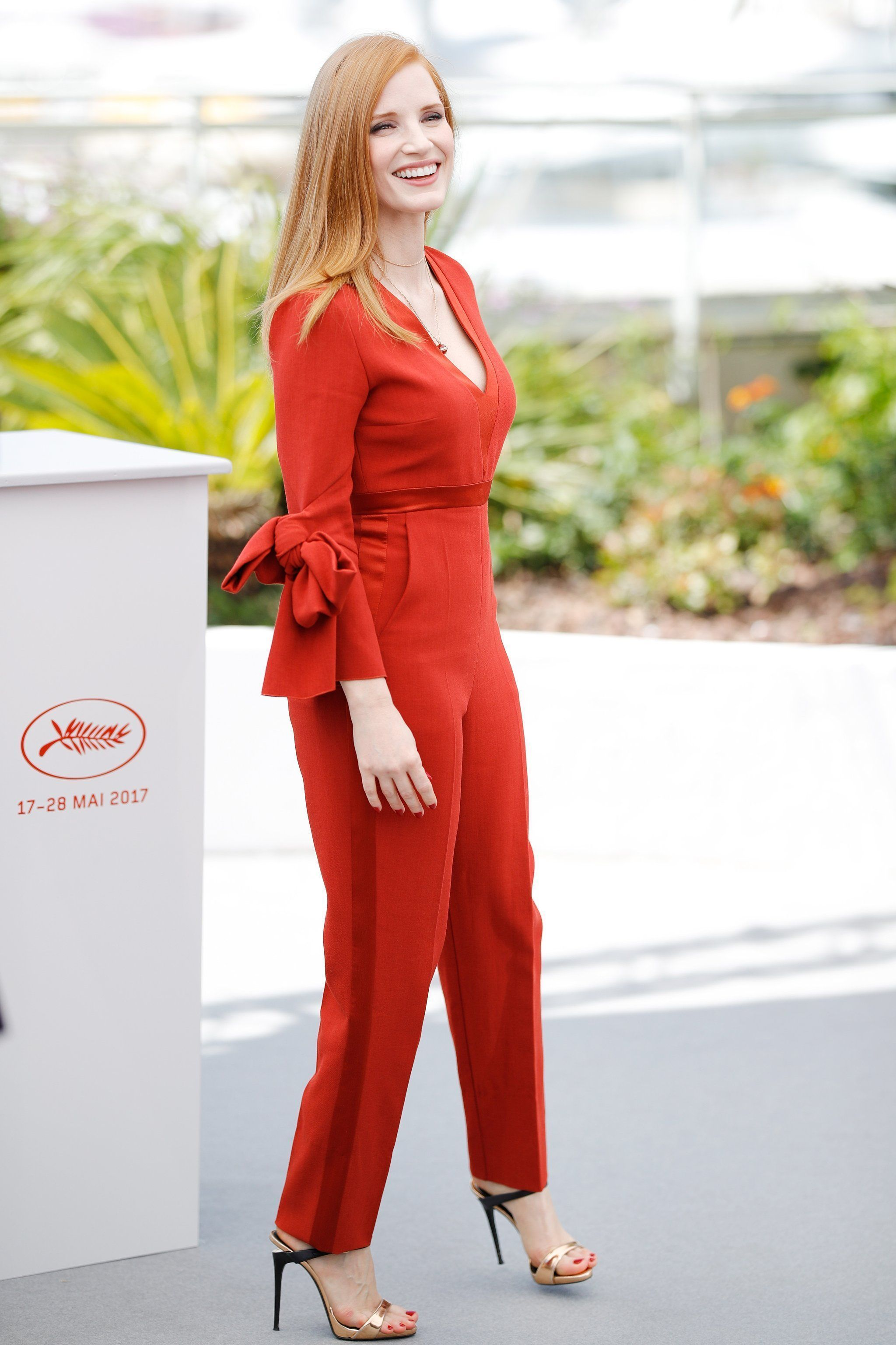 0e46738f2a Jessica Chastain wore a red Roksanda jumpsuit with Giuseppe Zanotti black-and-gold-tone  heels.