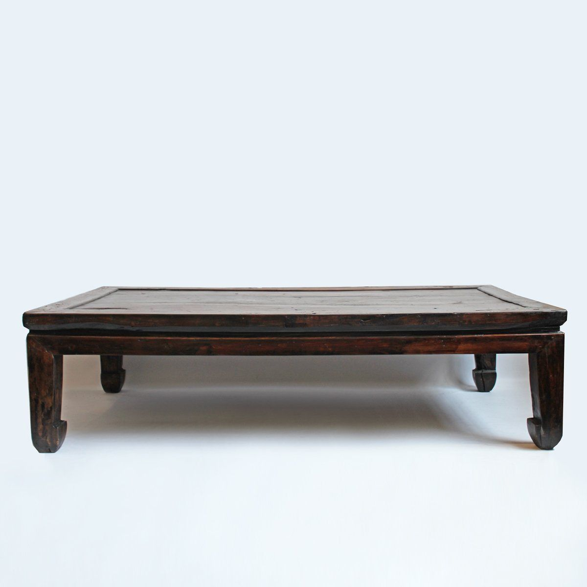 Original solid elm wood monk bed coffee table with dark espresso stain sealed in lacquer finish.