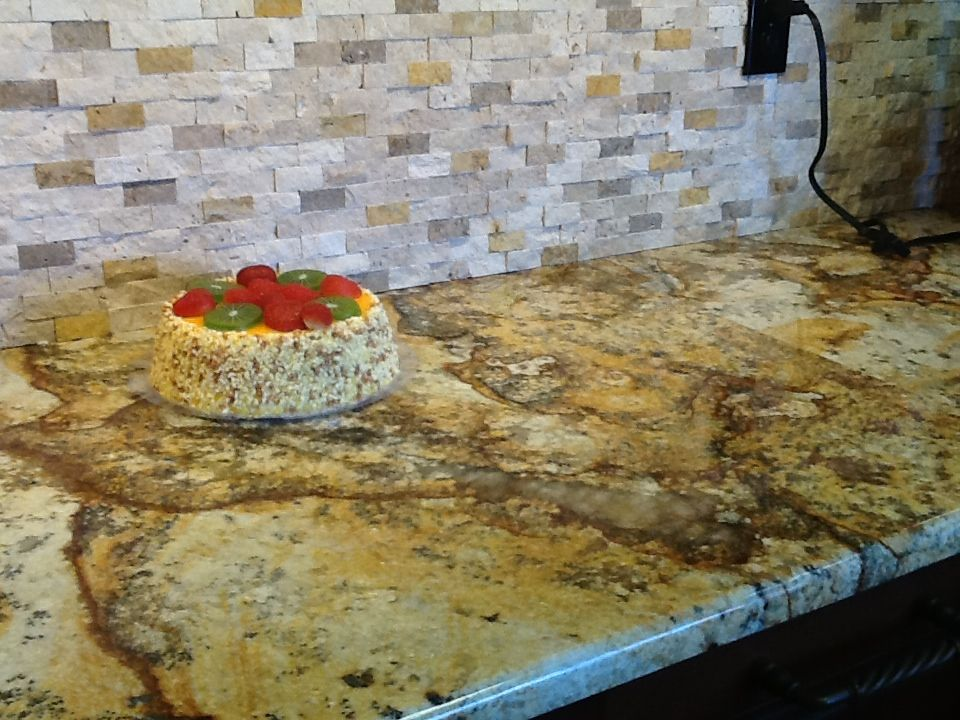 Golden Rustic Granite Installed On A Countertop At Steve Unser Cabinetry In Naples  Fl. This