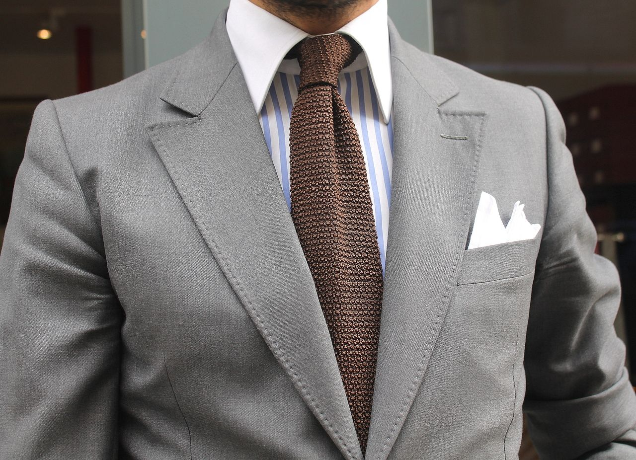 Grey suit from Marc Guyot. The outfit would work with a light ...