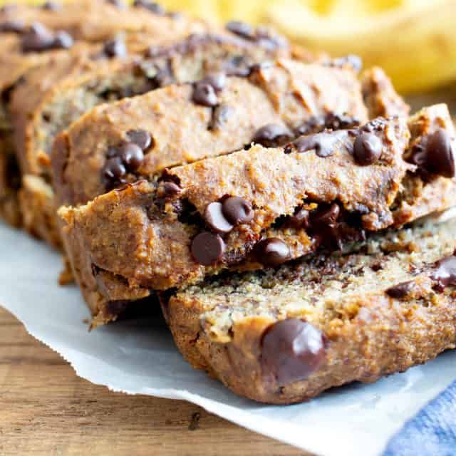 Best Moist Chocolate Chip Banana Bread Recipe (V, GF): a one bowl recipe for deliciously moist banana bread bursting with chocolate and made with healthy, whole ingredients. #Vegan #GlutenFree #DairyFree #Healthy #QuickBreads | Recipe at BeamingBaker.com #bananabreadbrownies