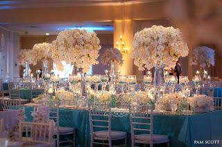 I love the big tall centerpieces! Except I'd love them on round tables!