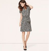 """Floral Tie Collar Dress - Topped off with a ruffled tie collar, this floral piece channels retro charm. Tie collar with keyhole. Short puff sleeves. Banded trim at cuffs. Shirred elasticized waist with removable self belt. Lined. 21"""" from waist seam. #loftclothes"""